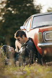 Handsome male model relaxing next to the car Royalty Free Stock Photography