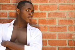 Handsome Male Model With Serious Look and Arms Fol. Expressive African American Male Portrait Royalty Free Stock Photos