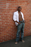 Handsome Male Model With Shirt Open Leaning Agains. Expressive African American Male Portrait Royalty Free Stock Photography