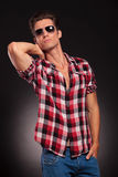 Handsome male model in  sunglasses posing Stock Photo