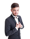 Handsome male model wearing tuxedo jacket and colored bow tie. Custom made. Fashionable man evening wear concept Royalty Free Stock Image