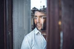 Handsome male near window royalty free stock photos