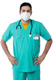 Handsome male nurse with hand on hips. Happy male doctor hold hands on waist Stock Image