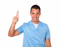 Handsome male nurse with luck sign Royalty Free Stock Image