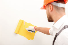 Handsome male painter is working in house Stock Photo