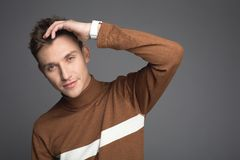 Handsome male person with stylish haircut stock photography