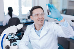 Handsome male person testing new chemical reagent Stock Images