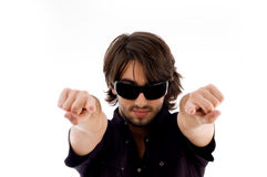 Handsome male pointing with both hands Royalty Free Stock Photos