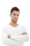 Handsome male. Portrait of young handsome male posing with arms crossed Stock Images