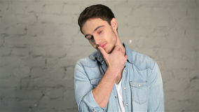 Handsome male posing in casual clothes stock footage