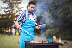 Handsome male preparing barbecue Royalty Free Stock Photo
