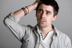 Handsome Male Scratching his Head. Shot of a Handsome Male Scratching his Head Royalty Free Stock Image