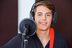 Handsome Male Singer Smiling While Wearing Royalty Free Stock Photography