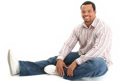Handsome Male Sitting On Floor Stock Photography