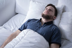 Handsome male with sleep disorder Stock Photo