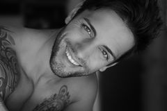 Handsome male smiling. Close Portrait of a handsome man smiling Royalty Free Stock Photo