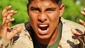 Handsome Male Soldier Under Stress. A handsome hispanic male teen Stock Photos