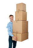 Handsome male with with stack of boxes Royalty Free Stock Photography