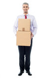 Handsome male with with stack of boxes. Isolated on white Royalty Free Stock Image