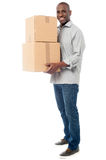 Handsome male with with stack of boxes Stock Photography