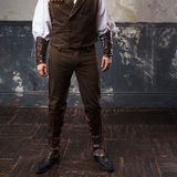 Handsome male Steam punk. Retro man over grunge background. Suit, pants and jacket, leather accessories. Handsome male Steam punk. Retro man portrait Royalty Free Stock Photography