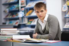 Handsome male student in a library. Handsome male student in a university library Royalty Free Stock Photos