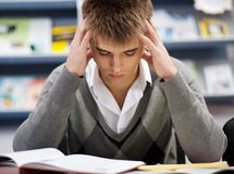 Handsome male student in a library. Handsome male student in a university library Stock Images