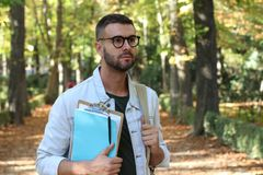 Handsome male student outdoors close up.  Stock Photos