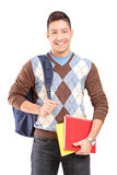 A handsome male student school bag holding books. Isolated against white background Royalty Free Stock Images
