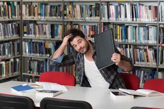 Frustrated Student Throwing His Laptop Royalty Free Stock Image