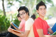 Handsome male students. Portrait of happy male students smiling and looking at camera outside Stock Images