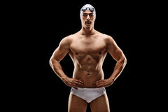 Handsome male swimmer in white swim trunks Royalty Free Stock Image