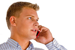 Handsome male talking on cell phone. On an isolated white background Royalty Free Stock Images