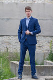 Handsome male teenager in blue suit. Smart young man teenager in business suit outdoors with blue jacket over shoulder stock photos