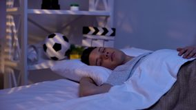 Handsome male teenager sleeping peacefully early in morning, promising boy stock photos