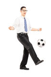 Handsome male with tie and shirt playing with a soccer ball Royalty Free Stock Photos