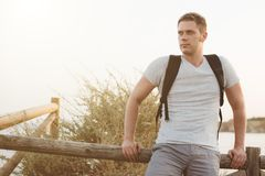 Handsome male tourist. Handsome male tourist with backpack. Space for text Royalty Free Stock Photos