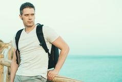 Handsome male tourist. Handsome male tourist with backpack. Space for text Royalty Free Stock Image