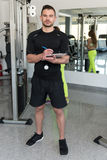 Handsome Male Trainer With Clipboard In A Gym Stock Photography
