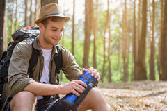 Handsome male traveler resting in nature Stock Photos