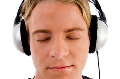 Handsome male tuned into music Royalty Free Stock Images