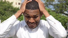 Handsome Male Under Stress. A handsome adult black man Stock Photos