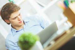 Handsome male using laptop Stock Photos