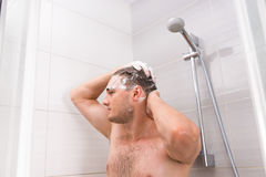 Handsome male washing his hair in shower cabin  in the bathroom Royalty Free Stock Photos