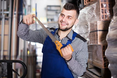 Handsome male worker showing his working tools Stock Image