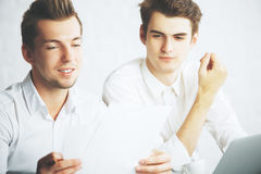 Handsome males doing paperwork Royalty Free Stock Photo
