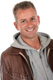 Handsome man. Handsome middle aged man in his forties  smiling.  Studio white background Stock Photography