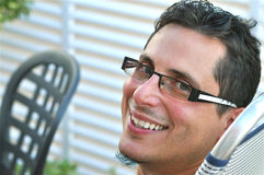 Handsome Man. A young man is smiling to the camera with a stylish glasses Stock Image