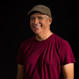 Handsome Man. Handsome middle age man wearing a hat on a black background Royalty Free Stock Image