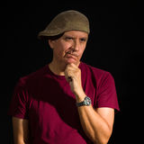 Handsome man. Handsome middle age man wearing a hat on a black background Royalty Free Stock Images